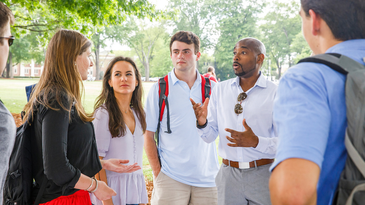 Professor and students in outdoor class
