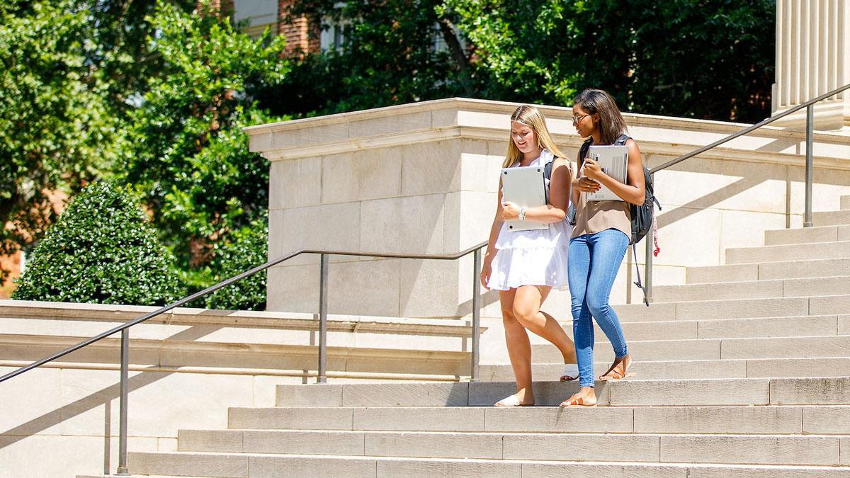 Students walking down stairs of Gorgas Library