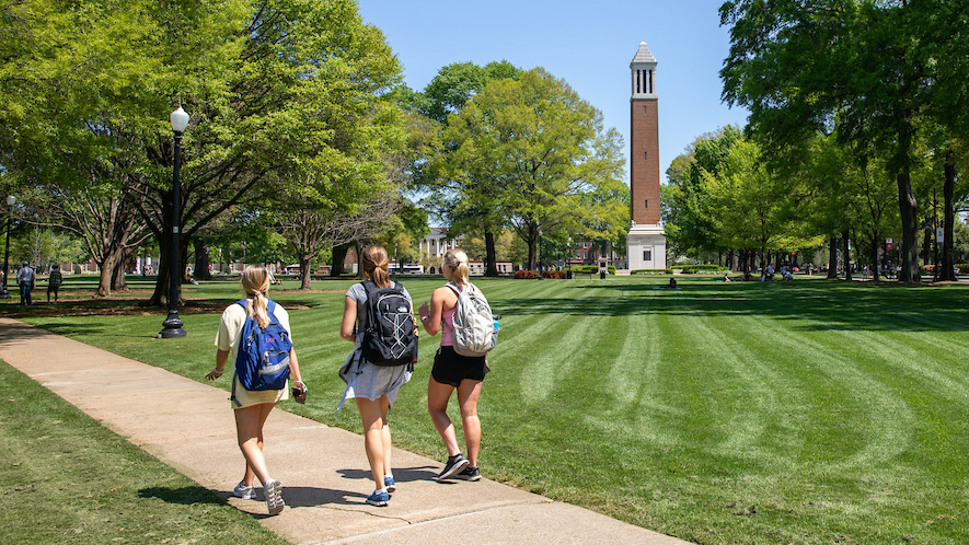 Students walking on the Quad with Denny Chimes in the background